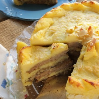 Alla prova del cuoco : torta ricca di carne e patate